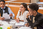 Purchase, NY – 31 October 2014. Gabriella Perez, center, makes a point to her team from Saunders Trades and Technical High School. The Business Skills Olympics was founded by the African American Men of Westchester, is sponsored and facilitated by Morgan Stanley, and is open to high school teams in Westchester County.