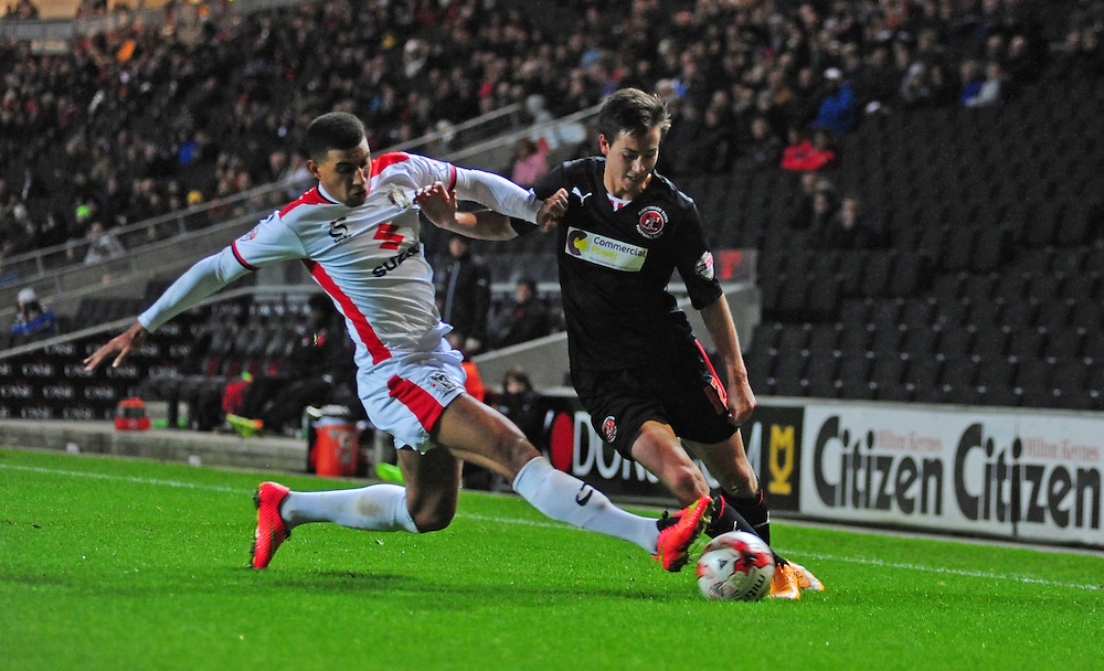 Fleetwood Town's Josh Morris vies for possession with Milton Keynes Dons' Daniel Powell<br /> <br /> Photographer Chris Vaughan/CameraSport<br /> <br /> Football - The Football League Sky Bet League One - Milton Keynes Dons v Fleetwood Town - Tuesday 21st October 2014 - Stadium:mk - Milton Keynes<br /> <br /> © CameraSport - 43 Linden Ave. Countesthorpe. Leicester. England. LE8 5PG - Tel: +44 (0) 116 277 4147 - admin@camerasport.com - www.camerasport.com