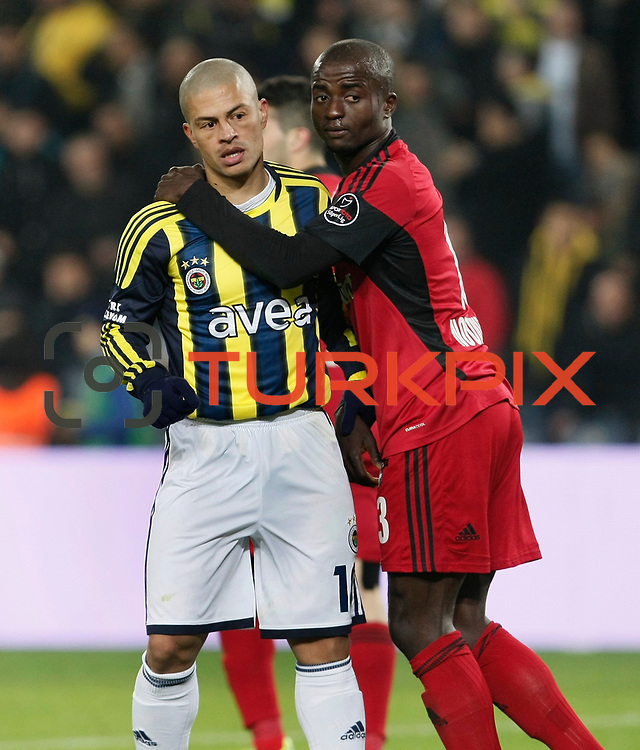 Fenerbahce's Alexsandro de Souza (L) and Gaziantepspor's Dany Nounkeu (R) during their Turkish superleague soccer match Fenerbahce between Gaziantepspor at the Sukru Saracaoglu stadium in Istanbul Turkey on Monday09 January 2011. Photo by TURKPIX