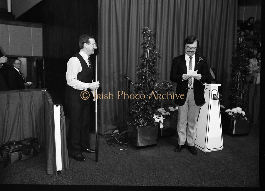 The Benson and Hedges .Irish Masters Snooker..1984..28.03.1984..03.28.1984..28th March 1984..The championship was held at Goffs,Co Kildare. All the top names in snooker took part..Steve Davis,Jimmy White,Eddie Charlton,.Tony Knowles,Dennis Taylor,Tony Meo,.Alex Higgins,Ray Reardon,.Cliff Thorburn,Terry Griffiths,.Bill Werbeniuk and Eugene Hughes..The eventual winner was Steve Davis who beat Terry Griffiths 9 -1 in the final..Image taken as Dennis Taylor is introduced to the audience before his meeting with Terry Griffiths..
