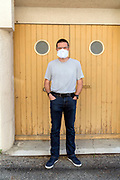 man with self made mask during the Covid 19 crisis and lockdown France Limoux May 2020