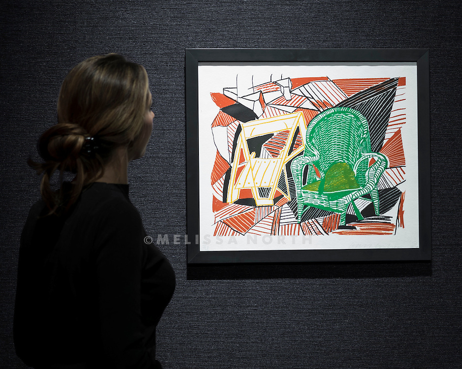 A member of staff at Bonhams looks at David Hockney Two Pembroke Studio Chairs, from Moving Focus est £3,300 - 4,600, at a preview of the auction highlights from the Estate of Lauren Bacall, at Bonhams, London, UK on 13th February 2015. The preview of 50 selected lots features works by Henry Moore, David Hockney, Robert Graham, Noel Coward and Jim Dine - and is due to be auctioned at Bonhams New York on 31 March and 1 April 2015.