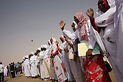 Darfurian women line-up on the tarmac of Al Fashir airport, Sudan to greet British peer Lord Ahmed of Rotheram who has brought over from the UK, a delegation to attend the first-ever international Conference on Womens' Challenge in Darfur, hosted by the govenor in his own compound. Nazir, Baron Ahmed (born 1958) is a member of the House of Lords, having become the United Kingdom's first Muslim life peer in 1998.