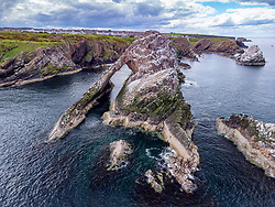 Aerial view of Bow Fiddle Rock at Portknockie on Moray Firth in Moray, Scotland, UK