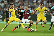 Sofiane Feghouli of West Ham United is intercepted by Zan Majer of NK Domzale and Alvaro Brachi of NK Domzale.  UEFA Europa league, 3rd qualifying round match, 2nd leg, West Ham Utd v NK Domzale at the London Stadium, Queen Elizabeth Olympic Park in London on Thursday 4th August 2016.<br /> pic by John Patrick Fletcher, Andrew Orchard sports photography.