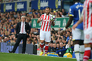 Erik Pieters of Stoke City prepares to take a throw- in while Stoke City Manager Mark Hughes looks on. Premier league match, Everton v Stoke city at Goodison Park in Liverpool, Merseyside on Saturday 27th August 2016.<br /> pic by Chris Stading, Andrew Orchard sports photography.
