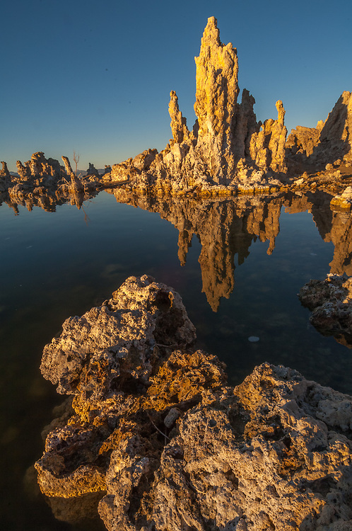 Reflection of tufa towers on Mono Lake, April, afternoon light, Mono Lake State Natural Reserve, eastern Sierra Mountains, Inyo County, California, USA