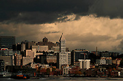 Dramatic clouds pass by the Seattle skyline at Smith Tower. (Erika Schultz / The Seattle Times)