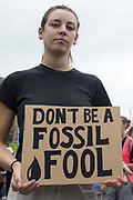 An environmental activist from Extinction Rebellion holds a sign in Trafalgar Square during the first day of Impossible Rebellion protests on 23rd August 2021 in London, United Kingdom. Extinction Rebellion are calling on the UK government to cease all new fossil fuel investment with immediate effect.