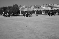 People seated at pond in Tuileries gardens, Paris, France<br />