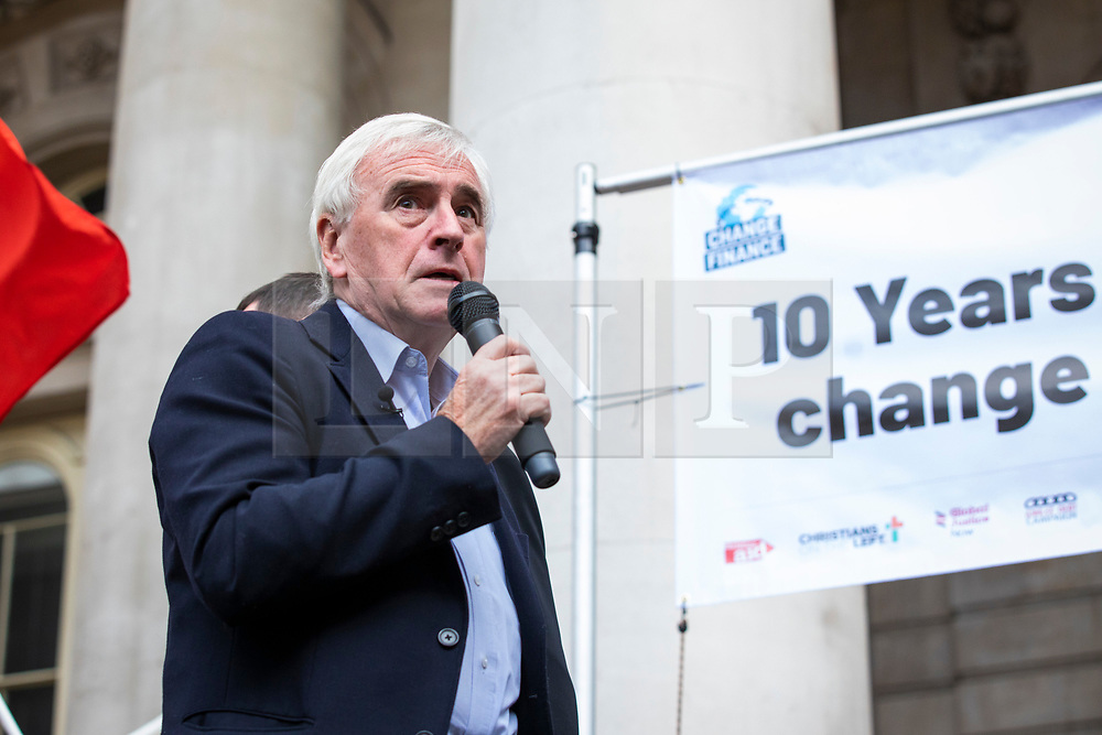 © Licensed to London News Pictures. 15/09/2018. London, UK. Shadow Chancellor John McDonnell MP speaks at a rally outside The Royal Exchange in the City of London to mark the 10th anniversary of the financial crisis. Photo credit: Rob Pinney/LNP