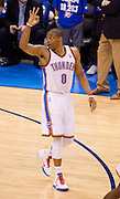 June 2, 2012; Oklahoma City, OK, USA; Oklahoma City Thunder guard Russell Westbrook (0) reacts to a 3-point basket during the second half of a playoff game against the San Antonio Spurs at Chesapeake Energy Arena.  Thunder defeated the Spurs 109-103 Mandatory Credit: Beth Hall-US PRESSWIRE