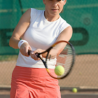 Eva Pogany plays tennis on one of the common courts in Budapest, Hungary. 27. August 2008. ATTILA VOLGYI