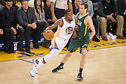 Golden State Warriors forward Kevin Durant (35) attacks the basket against the Utah Jazz at Oracle Arena in Oakland, Calif., on December 20, 2016. (Stan Olszewski/Special to S.F. Examiner)