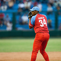 15 February 2009: Right pitcher Vladimir Garcia of the Orientales pitches during a training game of Cuba Baseball Team for the World Baseball Classic 2009. The national team is pitted against itself, divided in two teams called the Occidentales and the Orientales. The Orientales win 12-8, at the Latinoamericano stadium, in la Habana, Cuba.