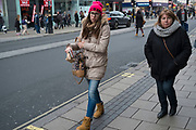Shopper on Oxford Street wearing a wool hat which reads the word TWERK. London, England, UK. Twerking is a type of dancing in which an individual, usually a female, dances to music in a sexually provocative manner involving thrusting hip movements and a low squatting stance.
