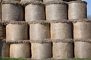 Stack of round straw bales in barn
