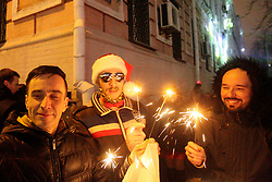 January 1, 2018 - Kyiv, Ukraine - Men hold sparklers as they celebrate New Year near Sofiiska Square, Kyiv, capital of Ukraine, January 1, 2018. Ukrinform. (Credit Image: © Bagmut_pavlo/Ukrinform via ZUMA Wire)