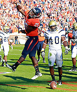 Oct. 15, 2011-Charlottesville, VA.-USA-  Virginia Cavaliers running back Kevin Parks (25) celebrates a first quarter touchdown in front of Georgia Tech linebacker Julian Burnett (40) during an ACC football game at Scott Stadium. Virginia won 24-21. (Credit Image: © Andrew Shurtleff