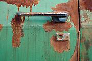 close up of door handle of an old rusty big American car