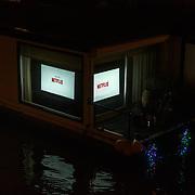NLD/Amsterdam/20171221 - Netflix verlicht Amsterdam voor de film Bright, Netflix woonboot Nieuwe Prinsengracht
