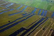 Nederland, Overijssel, Gemeente Steenwijkerland, 08-09-2009. Nationaal Park De Weerribben. Het landschap is het resultaat van het winnen van turf, na het steken van de turf (waardoor de 'trekgaten' ontstonden) werd dit te drogen gelegd op legakkers (de 'ribben'). Tegenwoordig vindt er rietteelt plaats (dekriet). Het laagveen gebied verdroogd en verruigt waardoor veenheiden of moerasbossen ontstaan. <br /> The National Park Weerribben. The landscape is the result of the extraction of peat, after digging the peat (creating  the 'pull holes'), it was to layed to dry on fields (the 'ribs'). As the paet bog fields become more dry, peat swamp forests occur.<br /> toeslag); aerial photo (additional fee required); <br /> foto Siebe Swart / photo Siebe Swart