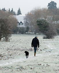 © under license to London News pictures. 27/11/2010. A walks his dog through countryside near Shefford, Bedfordshire this morning (27/11/2010). The whole of the UK is expected experience sub zero temperatures and heavy snowfall over the next few weeks. Photo credit should read: Stephen Simpson/LNP