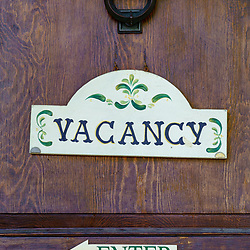 Lititz, PA, USA - August 21, 2020: An old-fashioned vacancy sign on the front door of a building offering lodging in the downtown area.
