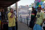 Hip Hop rappers playing a gig in favela Do Moinho. Before their community watches the World Cup 2014 opening game of Brazil vs Croatia. Outside in favela Do Moinho, Sao Paulo, Brazil.