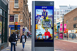 Glasgow, Scotland, UK. 26 October 2020. View of Glasgow city centre on weekday during circuit breaker lockdown with bars and restaurants closed. Pictured; Coronavirus advice on video screen on Sauchiehall Street . Iain Masterton/Alamy Live News