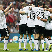 Germany's Thomas MULLER (C) celebrate his goal with team mate during their UEFA EURO 2012 Qualifying round Group A matchday 19 soccer match Turkey betwen Germany at TT Arena in Istanbul October 7, 2011. Photo by TURKPIX