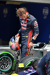 19.04.2014, International Circuit, Shanghai, CHN, FIA, Formel 1, Grand Prix von China, Qualifying Tag, im Bild Jean-Eric Vergne (FRA) Scuderia Toro Rosso looks the Red Bull Racing RB10 tyres in parc ferme. // during the Qualifyingday of Chinese Formula One Grand Prix at the International Circuit in Shanghai, China on 2014/04/19. EXPA Pictures © 2014, PhotoCredit: EXPA/ Sutton Images<br /> <br /> *****ATTENTION - for AUT, SLO, CRO, SRB, BIH, MAZ only*****