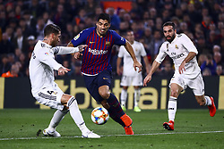 February 6, 2019 - Barcelona, Spain - SERGIO RAMOS in action against FC Barcelona's forward Luis Suarez  (C) During semifinal of spanish King Cup frist leg match between FC Barcelona and Real Madrid at  Nou Camp Stadium on February  6, 2019. (Credit Image: © Jose Miguel Fernandez/NurPhoto via ZUMA Press)