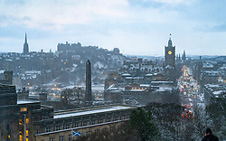 Edinburgh, Scotland, UK. 9 Feb 2021. Big freeze continues in the UK with Storm Darcy bringing several inches of snow to Edinburgh overnight. Pic; Snow flurries blow across Edinburgh viewed from Calton Hill. Iain Masterton/Alamy Live news