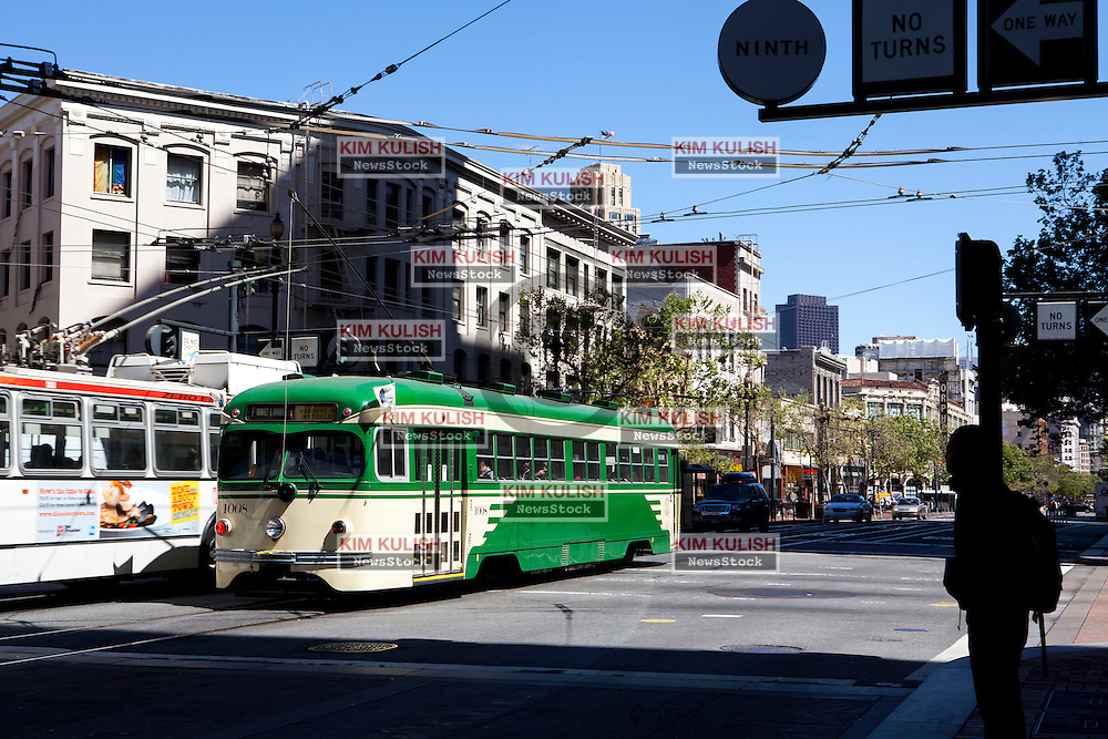 Scenes from along Market Street, near the new Twitter HQ San Francisco, California.  Buses and trolleys pass new by the Twitter HQ..