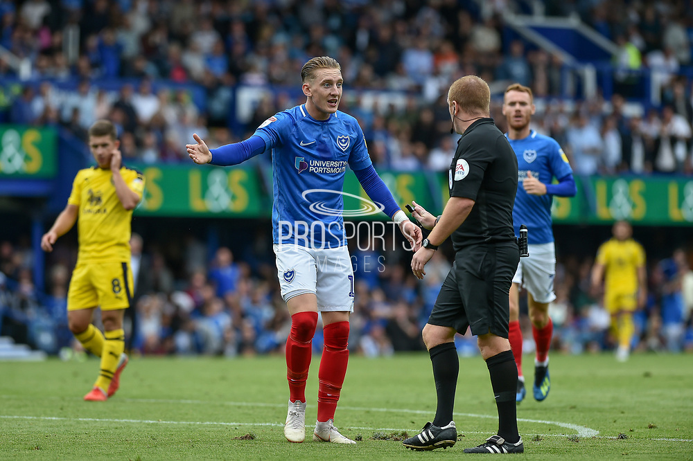 Portsmouth Midfielder, Ronan Curtis (11) thinks it should be a card for the foul on Portsmouth Forward, Oliver Hawkins (9) during the EFL Sky Bet League 1 match between Portsmouth and Oxford United at Fratton Park, Portsmouth, England on 18 August 2018.