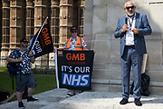 Jon Trickett, Labour MP for Hemsworth, addresses NHS workers from the grassroots NHSPay15 campaign outside Parliament before a march to 10 Downing Street to present a petition signed by over 800,000 people calling for a 15% pay rise for NHS workers on 20th July 2021 in London, United Kingdom. At the time of presentation of the petition, the government was believed to be preparing to offer NHS workers a 3% pay rise in recognition of the unique impact of the pandemic on the NHS.