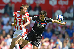 Stoke City's Peter Crouch out jumps Crystal Palace's James Tomkins
