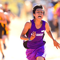 101213  Adron Gardner/Independent<br /> <br /> Miyamura Patriot Andrew Reeder gives it everything he's got while lunging across the finish line at the Zuni Invitational cross country meet in Zuni Saturday.
