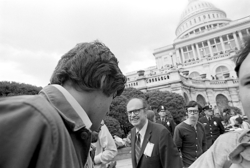 On April 22, 1971, Vietnam veteran Lt. John Kerry became the first Vietnam veteran to testify before Congress about the war, when he appeared before a Senate committee hearing on proposals relating to ending the war.<br /> Kerry is shown here on the U.S. Capitol steps the day after his testimony - April 23, 1971 - just after delivering an antiwar message as he participated in a demonstration with thousands of other veterans in which he and other veterans threw their medals and ribbons over a fence erected at the front steps of the United States Capitol building to dramatize their opposition to the war. - To license this image, click on the shopping cart below -