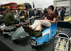© Licensed to London News Pictures. 13/09/2013. Chichester, UK A 'Mod' sits on his scooter. People enjoy the atmosphere at the 2013 Goodwood Revival. The event recreates the glorious days of motor racing and participants are encouraged to dress in period dress. The revival is the only event of its kind to be staged entirely in the nostalgic time capsule of the 1940s, 50s and 60s Photo credit : Stephen Simpson/LNP.