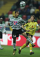 """PORTUGAL - AVEIRO 21 NOVEMBER 2004: (L to R) LIEDSON  #31 and RIBEIRO #25 in the 11¼ leg of the Super Liga, season 2004/2005, match  SC Beira Mar vs Sporting CP (2-2), held in """"Mario Duarte"""" stadium,  21/11/2004  01:40:01<br />(PHOTO BY: NUNO ALEGRIA/AFCD)<br /><br />PORTUGAL OUT, PARTNER COUNTRY ONLY, ARCHIVE OUT, EDITORIAL USE ONLY, CREDIT LINE IS MANDATORY AFCD-PHOTO AGENCY 2004 © ALL RIGHTS RESERVED"""