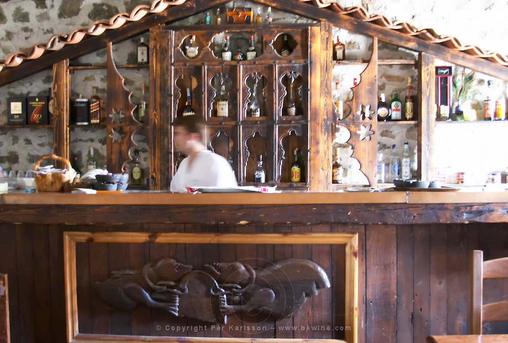 The upstairs bar with traditional country style wooden carvings and decoration Tradita traditional restaurant, Shkodra. Albania, Balkan, Europe.