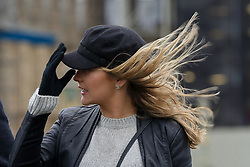 © Licensed to London News Pictures. 09/02/2020. London, UK. A woman holds to her cap during blustery conditions on Westminster Bridge from Storm Ciara. Heavy rain and strong winds are forecast for the rest of today as the Storm Ciara sweeps across the UK. Photo credit: Dinendra Haria/LNP