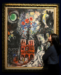 """© Licensed to London News Pictures. 14/06/2012. London, UK A woman looks at Marc Chagall's """"L'Arbre de Jesse' estimated to fetch 3-5 MillionGBP. Photocall for Sotheby's June Impressionist and Modern Art Sale this June. Photo credit : Stephen Simpson/LNP"""