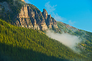 Morning clouds swirling about Mt. Temple northeast of Moraine Lake at sunrise.<br />Banff National Park<br />Alberta<br />Canada