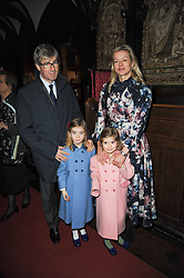 TIM & LADY HELEN TAYLOR with their daughters ELOISE and ESTELLA at a Christmas Carol service in aid of Breast Cancer Haven held at St.Paul's Knighsbridge, Wilton Place, London on 8th December 2009.
