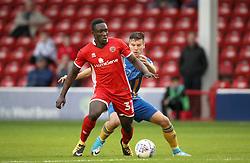 Walsall's Daniel Agyei holds off challenge from <br />Shrewsbury Town's Mat Sadler