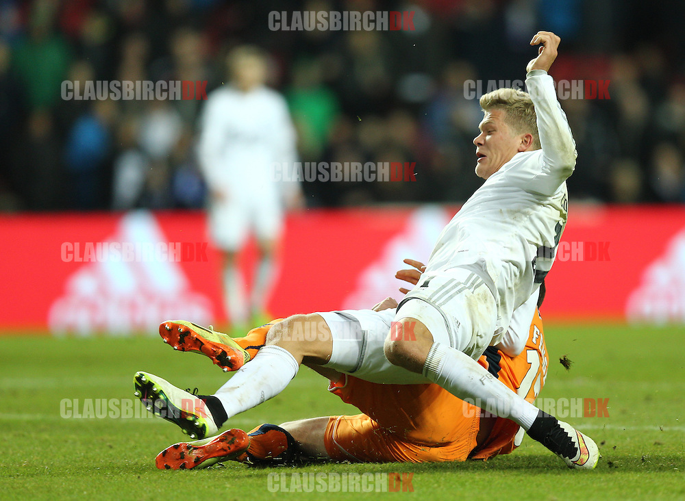 Andreas Cornelius of FC København is tackled by Mads Fenger of Randers FC during the Danish DBU Pokalen Cup match between FC København and Randers FC at Telia Parken on March 5, 2015 in Copenhagen, Denmark. (Photo by Claus Birch)