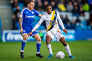 Gillingham FC defender Barry Fuller (12) and Oxford United forward Tariqe Fosu-Henry (11) during the EFL Sky Bet League 1 match between Gillingham and Oxford United at the MEMS Priestfield Stadium, Gillingham, England on 18 January 2020.